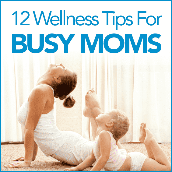 Mom and toddler dressed in white doing yoga together with the words 12 Wellness Tips For Busy Moms