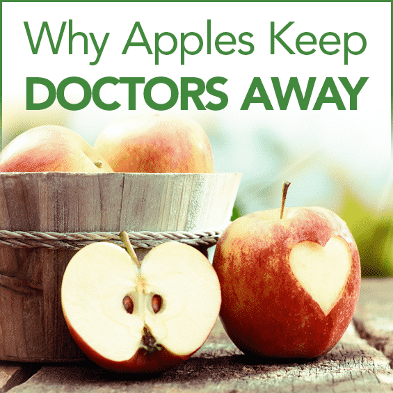 """A basket of apples on a wooden porch with the words """"Why an Apple a Day Can Keep the Doctor Away"""""""