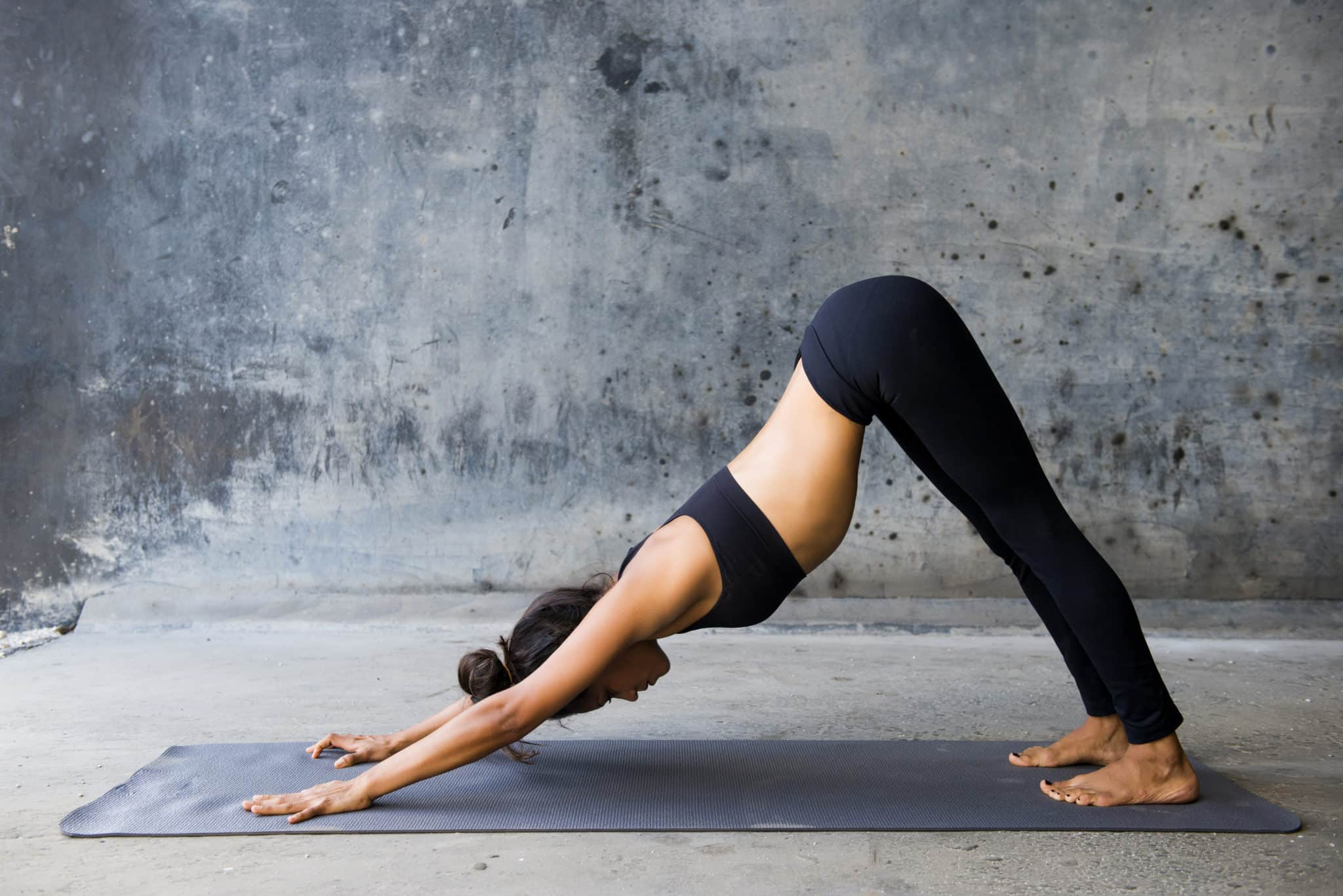 Learn How Poses Like Downward Dog Can Help Reduce Back Pain Naturally