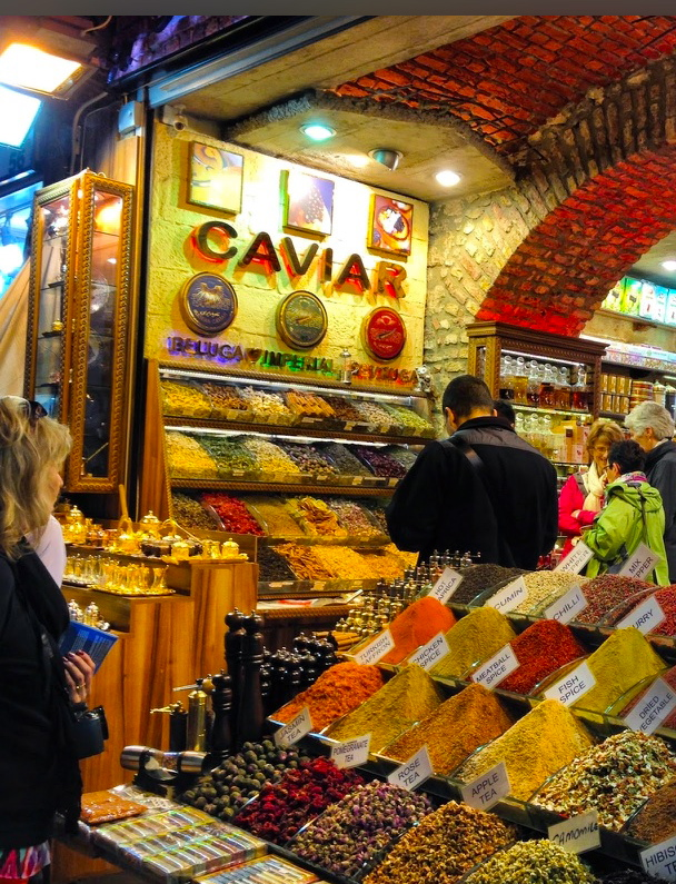 A market in Turkey with tables of fresh and colorful spices like cinnamon and Turmeric.