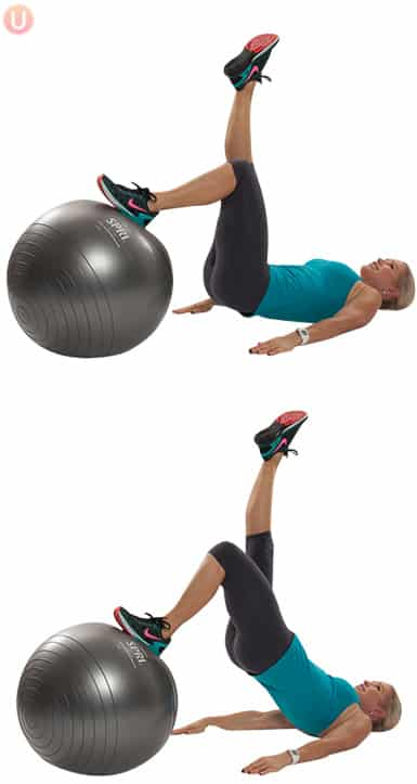 Chris Freytag performing lift and lower with one leg on stability ball wearing black yoga pants and blue top