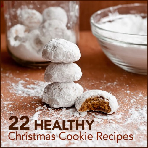 "Spiced Chai Snowball cookies stacked on a table with the words ""22 Healthy Christmas Cookie Recipes"" below."