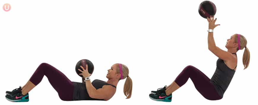 Chris Freytag demonstrating Ab Roll Up Toss in a black tank top holding a black medicine ball