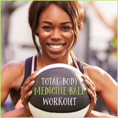 Young beautiful woman holding medicine ball for workout