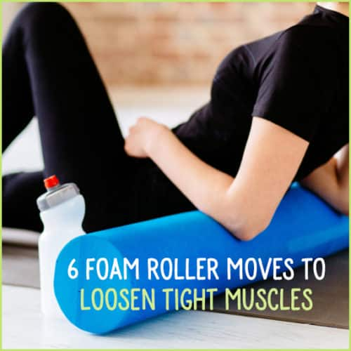 Woman in black workout clothes using foam roller on back