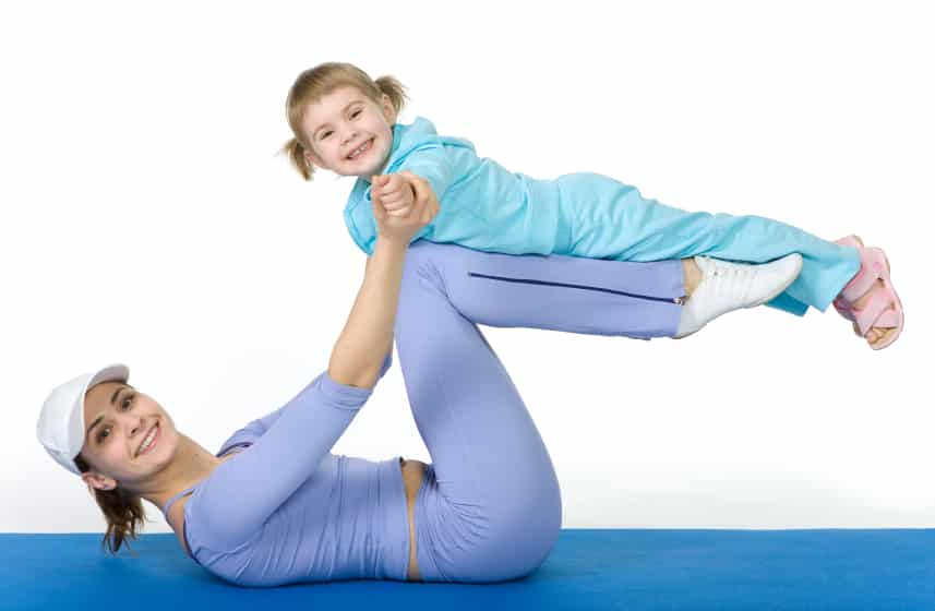 a woman playing with her daughter and burning calories too