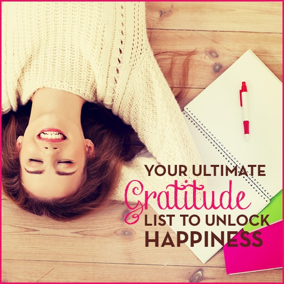 "Smiling woman laying on the floor with text ""Your Ultimate Gratitude List To Unlock Happiness"""