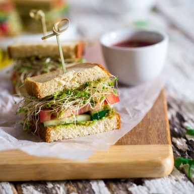 Your new favorite workday lunch = this veggie packed sandwich with avocado spread and sprouts!