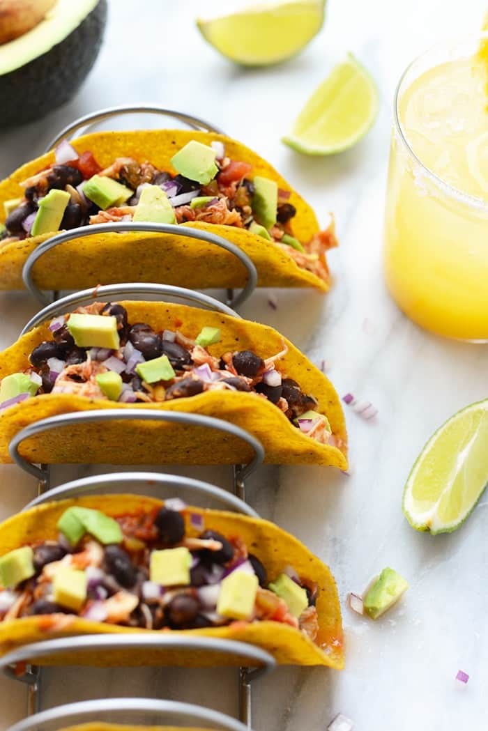 Whip up this gluten-free recipe for tender four ingredient crock-pot chicken tacos is so delicious and simple it will become one of your favorites!