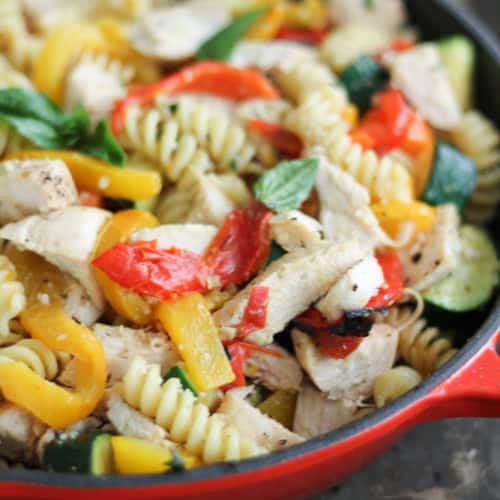 This healthy garlic parmesan pasta with chicken and roasted bell peppers is super delicious and full of protein for a low-calorie family meal everyone will love.