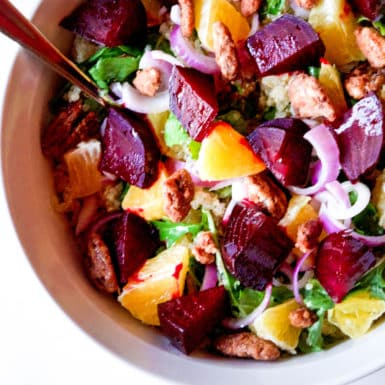 Beets, quinoa, arugula and so much more make this salad pack some major nutrition, flavor and color!