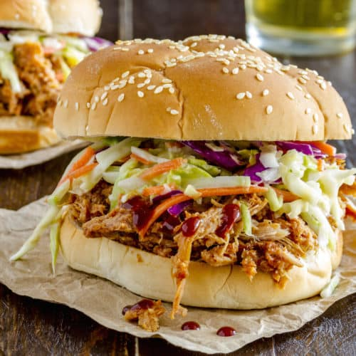Whip up this delicious gluten-free slow cooker raspberry barbecue pulled chicken recipe for a protein packed make ahead meal that tastes amazing!
