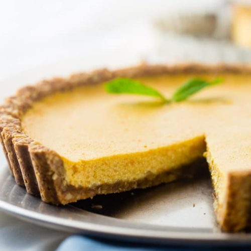 This easy healthy, and gluten free orange pie uses a secret ingredient to make it PACKED with protein and low in calories. It's perfect for breakfast, snack or dessert!