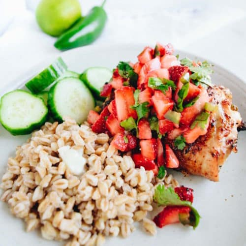 An easy grilled chili lime chicken recipe with a delicious, fresh cilantro strawberry salsa on top! It's so easy to throw together but tastes like you spent all day on it!