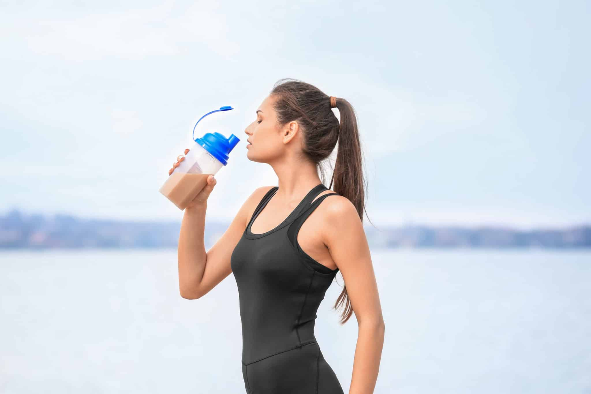 Fitness woman drinking protein shake