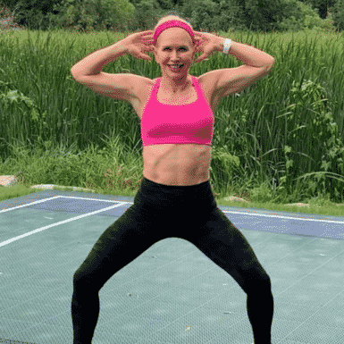 """Chris Freytag wearing pink sports bra with the text logo """"Get Healthy U"""""""